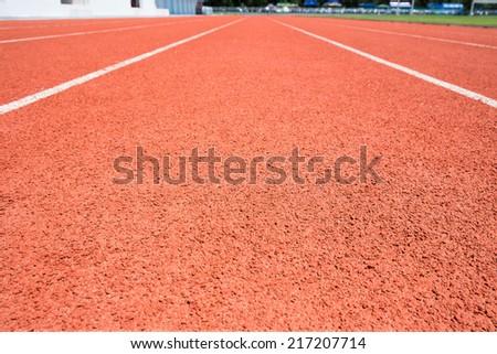 Rubber running lane for sprint or race. - stock photo