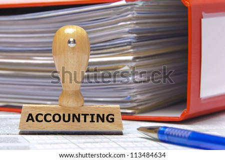 rubber stamp in office marked with accounting - stock photo