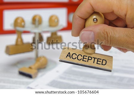 rubber stamp marked with accepted - stock photo