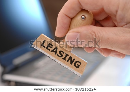 rubber stamp marked with leasing - stock photo