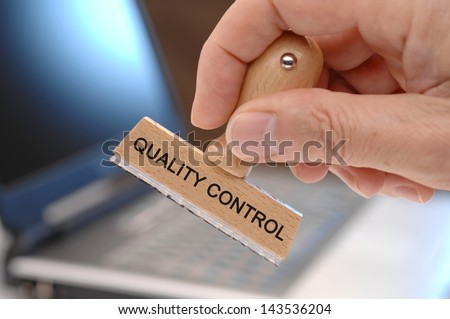 rubber stamp marked with quality control - stock photo