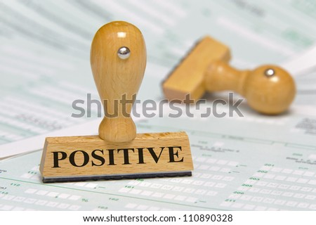 rubber stamp on paper documents marked with positive - stock photo