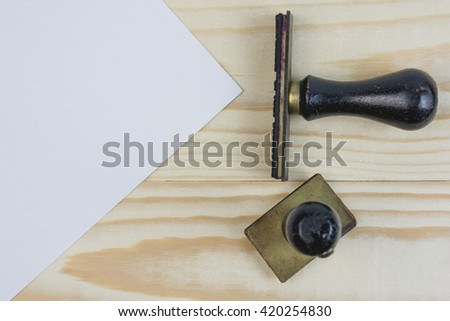 rubber stamp on wooden - stock photo