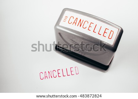 Rubber stamping Cancelled,The Cancelled rubber stamp on blurred financial document