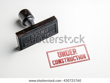 Rubber stamping that says 'Under Construction'. - stock photo