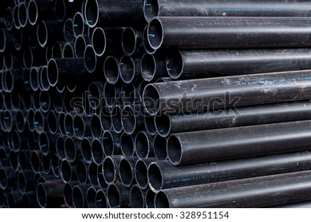 Rubber Water Hose Black color, underground PVC Flex Pipe. - stock photo