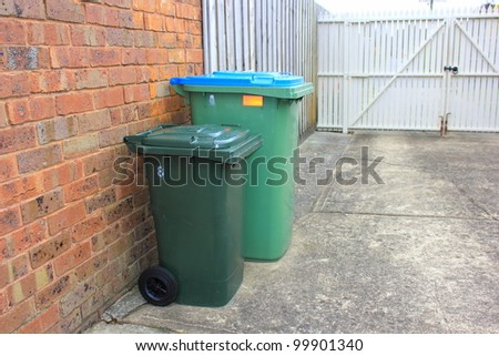 Rubbish and recycle bins in a typical suburban backyard in australia - stock photo