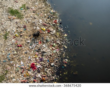 Rubbish at the river banks of the yamuna river - stock photo