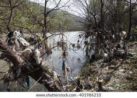Rubbish on the river bank - stock photo