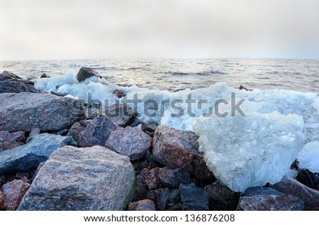 Rubble ice seashore landscape in Kronstadt near St. Petersburg, Russia  - stock photo