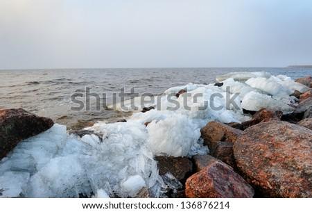 Rubble ice shoreline landscape in Kronstadt near St. Petersburg, Russia - stock photo