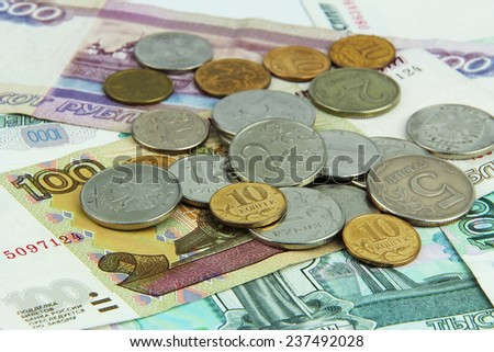 ruble banknotes and coins of different denominations closeup - stock photo