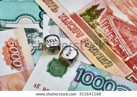 Ruble banknotes and dices cubes. Selective focus - stock photo