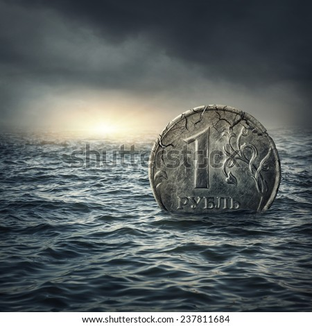 Ruble coin sinking in water.Russian economic crisis concept - stock photo