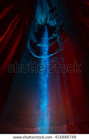Ruby Falls underground waterfall lit in blue and red located in a cavern within the Lookout Mountain near Chattanooga, TN, USA. - stock photo