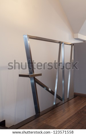 Ruby house - Closeup of modern and original silver banister - stock photo