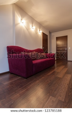 Ruby house - couch on hallway at a modern house - stock photo