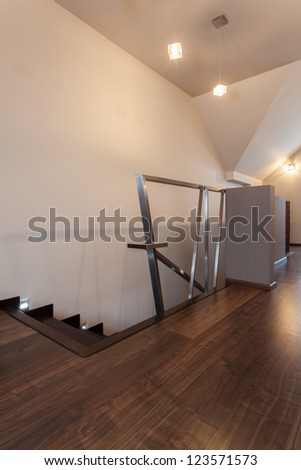 Ruby house - Stairs with original metal banister, modern interior