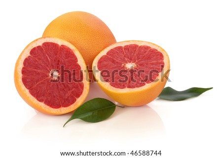 Ruby red grapefruit with leaves, isolated over white background with reflection.