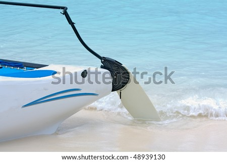 Rudder of a sailboat sticking in the sand on a beach in the Bahamas - stock photo