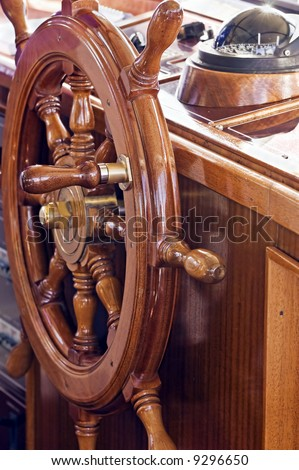 Rudder with compass in background on a yacht - stock photo
