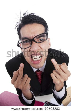 Rude and Angry businessman giving the finger - stock photo
