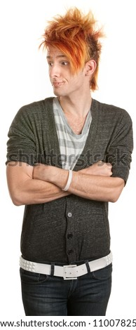 Rude teen with orange mohawk and folded arms - stock photo