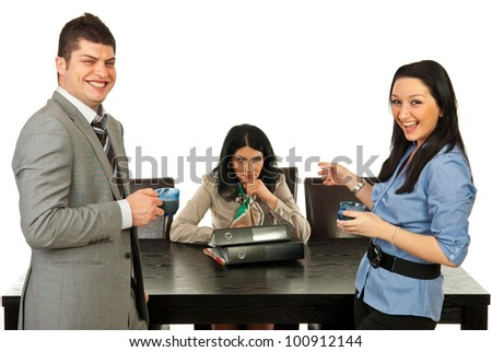 Rude two business people in coffee break laughing out loud of their colleague woman
