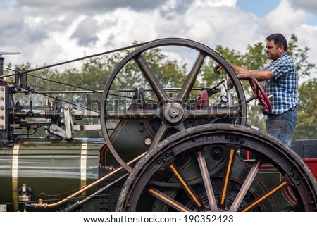 RUDGWICK, SUSSEX/UK - AUGUST 27 : Traction engine at Rudgwick Steam Fair in Rudgwick Sussex on August 27, 2011. Unidentified man.