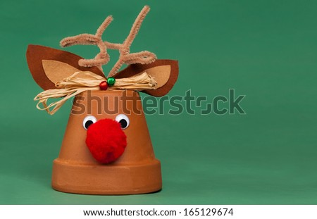 Rudolph The Red-Nosed Reindeer Flower Pot Christmas Decoration - stock photo