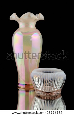 Ruffled Pink Lusterware Vase (circa 1920's) with mirror image, black reflection background. - stock photo