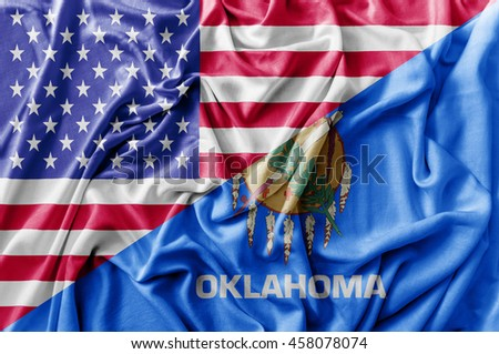 Ruffled waving United States of America and Oklahoma flag - stock photo