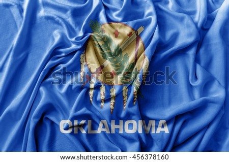 Ruffled waving United States Oklahoma flag - stock photo
