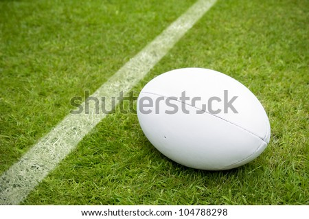 rugby ball near try line on rugby pitch with copy space - stock photo