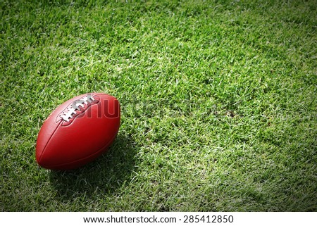 Rugby ball on green field