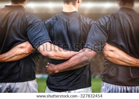 Rugby fans in arena against rugby players standing together before match - stock photo