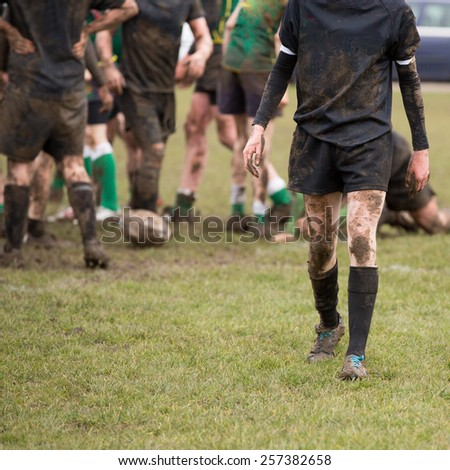 Rugby, muddy game of rugby, square cropped, - stock photo