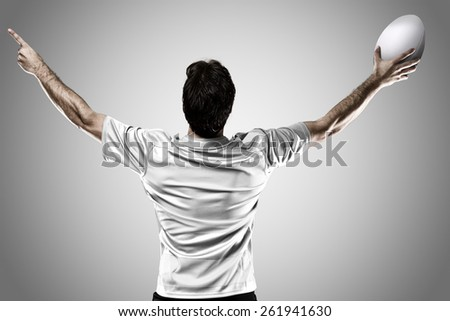 Rugby player in a white uniform celebrating on a white background. - stock photo