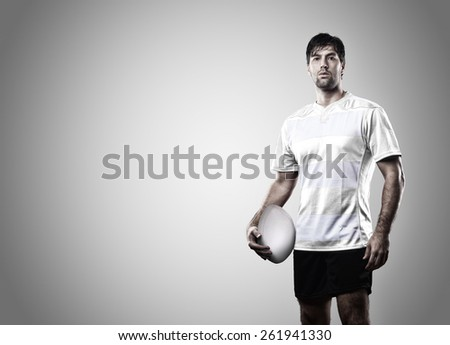 Rugby player in a white uniform on a white background. - stock photo