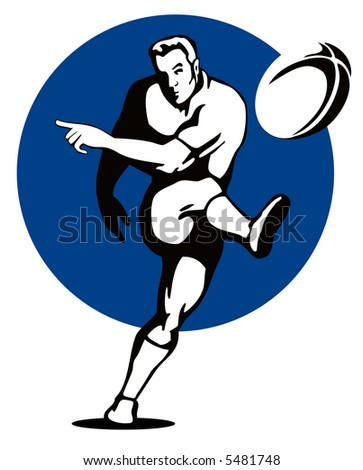 Rugby player kicking the ball - stock photo