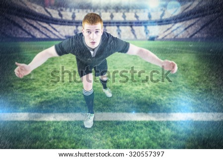 Rugby player tackling the opponent against rugby pitch