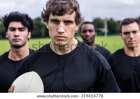 Rugby players standing together before match at the park - stock photo