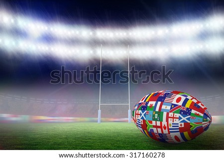 Rugby world cup international ball against rugby pitch - stock photo