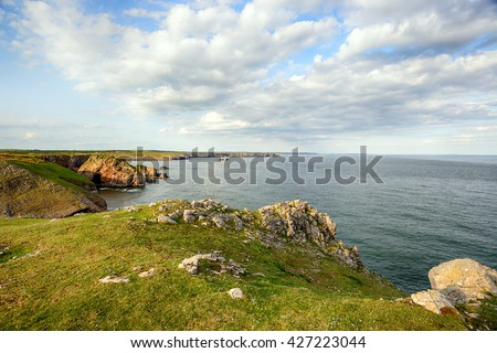 Rugged cliffs and coastline at St Govan's Head on the Pembrokeshire Coast National Park in Wales, looking out towards Stackpole