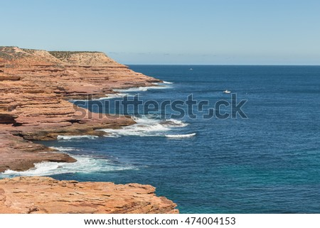 Rugged Coastal Cliffs shot on a Cloudless Summer Day with the Horizon over the Water