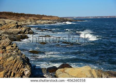 rugged coastline and crashing surf of conanicut  island, rhode island - stock photo