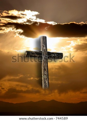 Rugged cross under a ray of sunshine through clouds.