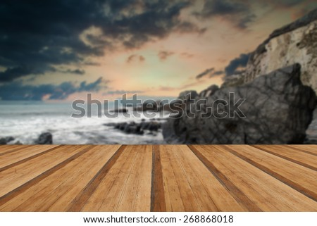 Rugged long exposure landscape seascape of rocky coastline with wooden planks floor - stock photo