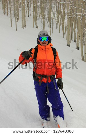 Rugged male skier with aspen tree background in the Utah mountains, USA. - stock photo