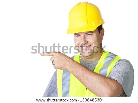 Rugged Male Worker Pointing to Empty Space - stock photo